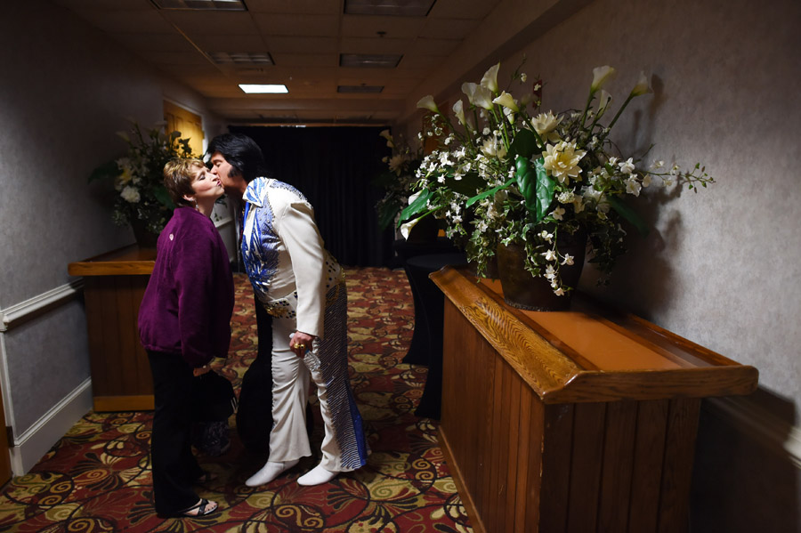 Tricia Sawilchik, left, greets Elvis tribute artist, Ernie Hefferon backstage during the Ocean City Elvis Festival at the Clarion Resort Fontainebleau Hotel on Friday October 23, 2015 in Ocean City, MD.