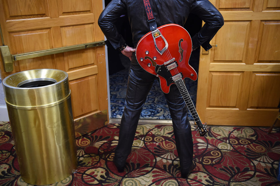 Elvis tribute artist, Ryan Pelton prepares to perform in the finals of the Ocean City Elvis Festival contest at the Clarion Resort Fontainebleau Hotel on Sunday October 25, 2015 in Ocean City, MD.