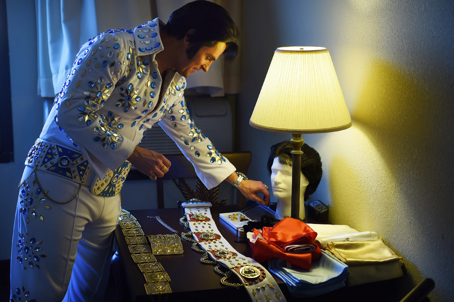 David King, 42, transforms himself into Elvis Presley in his hotel room at the Clarion Resort Fontainebleau Hotel before performing at the Ocean City Elvis Festival on Saturday October 24, 2015 in Ocean City, MD.