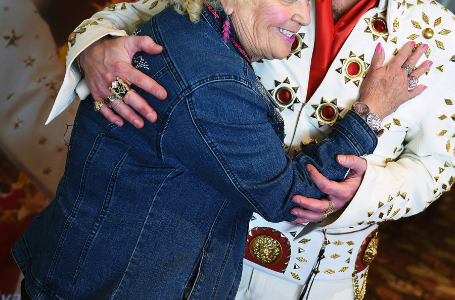 Eileen Erdman, left, embraces David King, 42, of Greencastle, PA after he performed at the Ocean City Elvis Festival which took place at the Clarion Resort Fontainebleau Hotel on Friday October 23, 2015 in Ocean City, MD. (Photo by Matt McClain/ The Washington Post)
