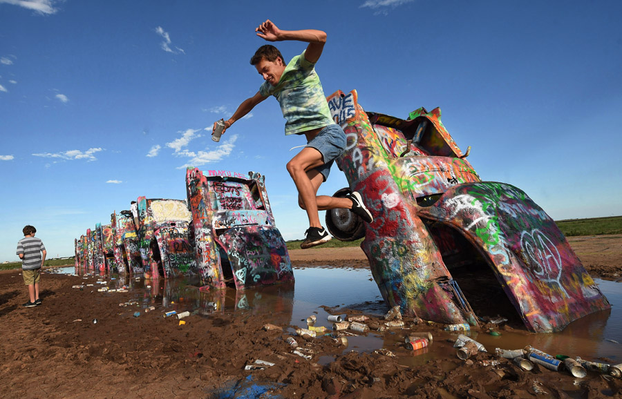 Jake Massima jumps off one of the buried vehicles at Cadillac Ranch on Wednesday July 22, 2015 outside of Amarillo, TX. (Photo by Matt McClain/The Washington Post)Jake Massima jumps off one of the buried vehicles at Cadillac Ranch on Wednesday July 22, 2015 outside of Amarillo, TX. (Photo by Matt McClain/The Washington Post)
