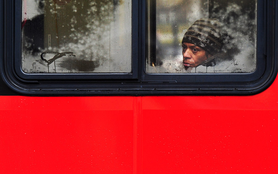 A Metrobus passenger gazes out a misty window as moisture moved through the region on Monday February 03, 2014 in Washington, DC.  (Photo by Matt McClain/ The Washington Post)
