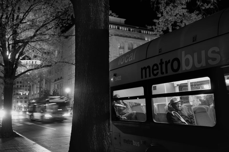 A man sits on a Metro bus as it makes a stop along H St. NW on Tuesday March 27, 2012 in Washington, DC.  (Photo by Matt McClain for The Washington Post)