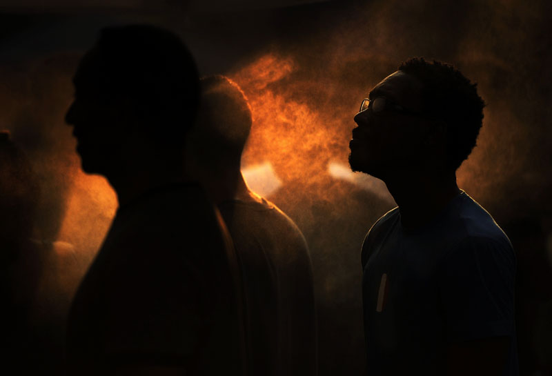 Cooling off, Carl McClinton, right, stands inside a misting tent with others at the 2011 Dance DC Festival that took place on F St. NW on Sunday July 24, 2011 in Washington, DC.  High temperatures were a constant theme throughout the summer.