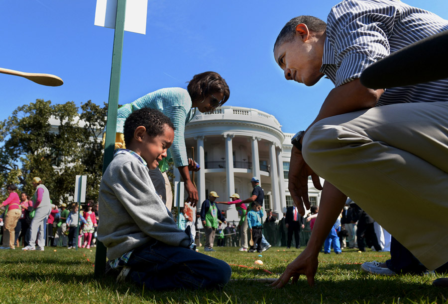 After finishing rolling an Easter egg, Donovan Frazier, 5, is consoled by President Barack Obama at the annual White House Easter Egg Roll on Monday April 01, 2013 in Washington, DC.  Kid President, Robbie Novak was in attendance as well as Washington Wizards players and others.  (Photo by Matt McClain/ The Washington Post)