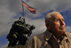 Norman {quote}Norm{quote} Hatch, 91, poses for a portrait near the U.S. Marine Corps War Memorial which is also referred to as the Iwo Jima Memorial on Wednesday February 20, 2013 in Arlington, VA.  Hatch was at Iwo Jima, in charge of the U.S. Marines 5th Division Photo Section.  The statue is a depiction of a photograph by Associated Press photographer, Joe Rosenthal of a flag raising during the Battle of Iwo Jima.  (Photo by Matt McClain for The Washington Post)