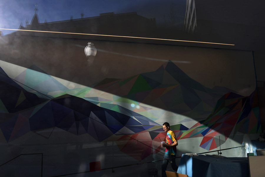 Artist, Jonathan Zawada walks by a mural he is working on at Pillsbury Winthrop Shaw Pittman LLP law firm on Wednesday January 28, 2015 in Washington, DC. (Photo by Matt McClain/ The Washington Post)