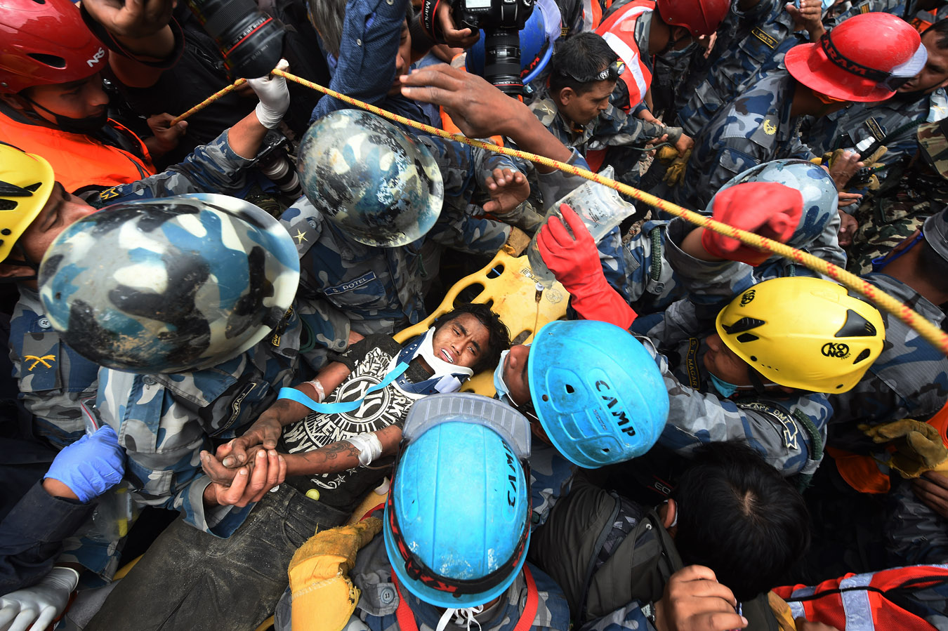 An earthquake survivor is carried away after Fairfax County emergency personnel working with USAID Disaster Assistance Response Team assisted in the effort to save Lama from the rubble on Thursday April 30, 2015 in Kathmandu, Nepal. A deadly earthquake in Nepal has killed thousands. (Photo by Matt McClain/ The Washington Post)