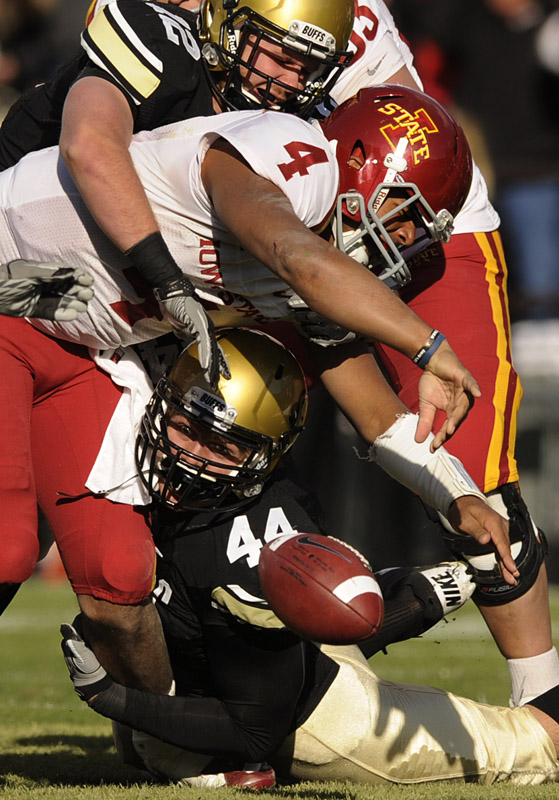 Colorado's Patrick Mahnke, top, and Nick Kasa, bottom, sack Iowa State's Austen Arnaud as the ball is forced out and returned for a Colorado touchdown in the fourth quarter of a NCAA college football game in Boulder, Colo. on Saturday, Nov.13, 2010.  Colorado defeated Iowa St. 34-14.  (AP Photo/ Matt McClain)