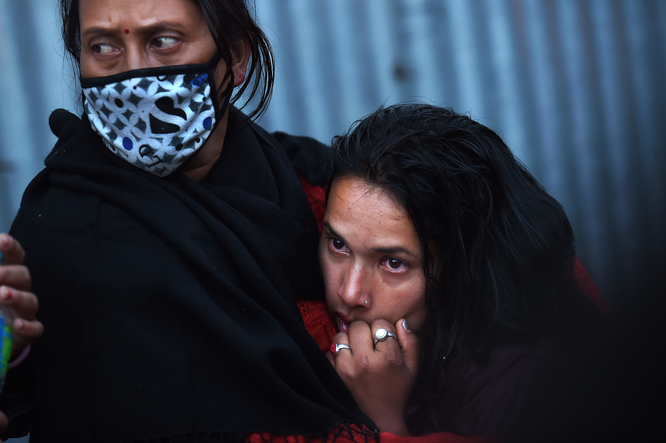 Babita Bhandani, right, mourns her brother, an earthquake victim during his funeral pyre at a Hindu temple on Wednesday April 29, 2015 in Kathmandu, Nepal. A deadly earthquake there has killed thousands. (Photo by Matt McClain/ The Washington Post)