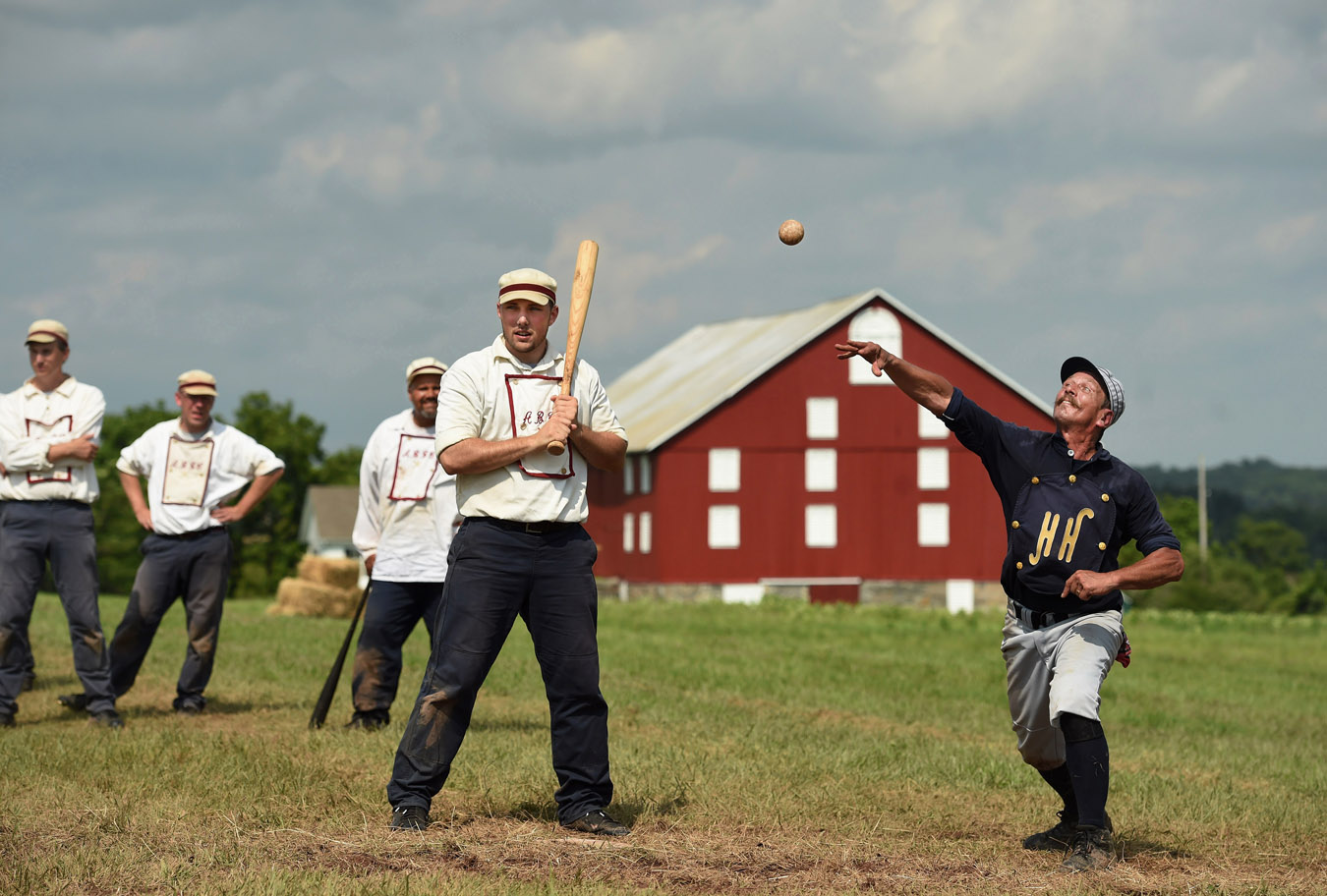 Rich {quote}Fingers{quote} Effinger, left, of the Atlantic Base Ball Club of Brooklin takes his turn at the plate as Jay {quote}Udderguy{quote} Kauflie, right, of the Hog and Hominy Base Ball Club of Tennessee makes a throw to second base to try to get a runner out during the Gettysburg National 19th Century Base Ball Festival on Saturday July 18, 2015 in Gettysburg, PA. Effinger's team is based in Smithtown, NY. The team pays tribute to a nineteenth century team called the Brooklyn Atlantics. (Photo by Matt McClain/The Washington Post)