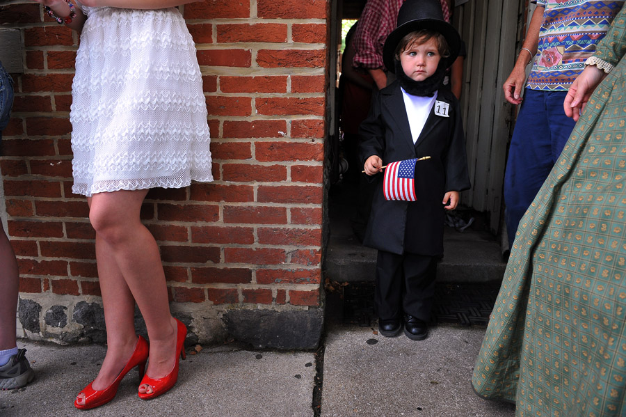 Koen Thomas, 4, right, waits his turn to compete in the Lincoln Look-Alike Contest outside the Shriver House Museum on Wednesday July 03, 2013 in Gettysburg, PA.  People have flocked to the town to commemorate the 150th anniversary of the Battle of Gettysburg.  The battle is considered a turning point in the Civil War.  (Photo by Matt McClain/ The Washington Post)