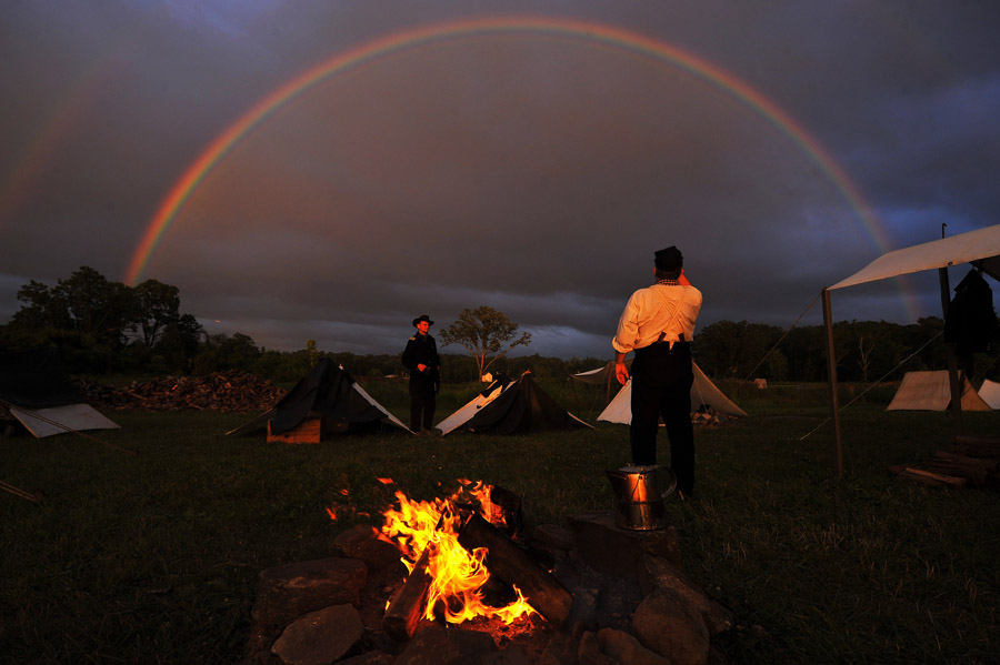 Union reenactors, Paul Carter of McLean, VA, left, and Paul Martinello, right, of Somers, CT are framed by a rainbow at Gettysburg National Military Park on Tuesday July 02, 2013 in Gettysburg, PA.  People have flocked to the town to commemorate the 150th anniversary of the Battle of Gettysburg.  The battle is considered a turning point in the Civil War.  (Photo by Matt McClain/ The Washington Post)