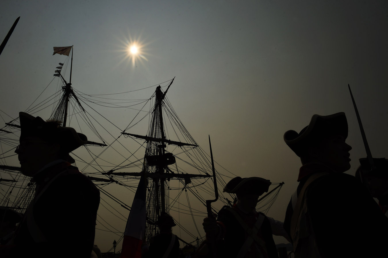 Reenactors are seen along with the French ship Hermione prior to a ceremony welcoming the vessel on Wednesday June 10, 2015 in Alexandria, VA. The Hermione is a replica of the ship that brought the Marquis de Lafayette back to America in 1780. (Photo by Matt McClain/ The Washington Post)
