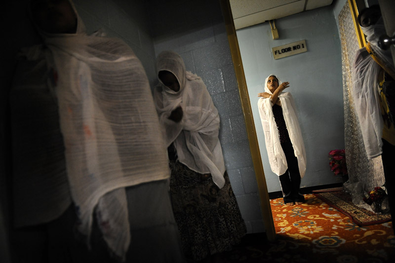Women pray during a church service prior to the traditional foot and hand washing at Debre Selam Kidist Mariam Church, an Ethiopian Orthodox church on Thursday April 21, 2011 in Washington, DC.  (Photo by Matt McClain/For The Washington Post)