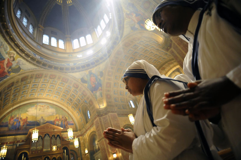 Members of the Missionaries of Charity, that say it is against the order to give their names, pray during the Chrism Mass at the Cathedral of Saint Matthew the Apostle on Monday April 18, 2011 in Washington, DC.  The Holy anointing oils that are used throughout the year were blessed during the mass.  (Photo by Matt McClain/For The Washington Post)