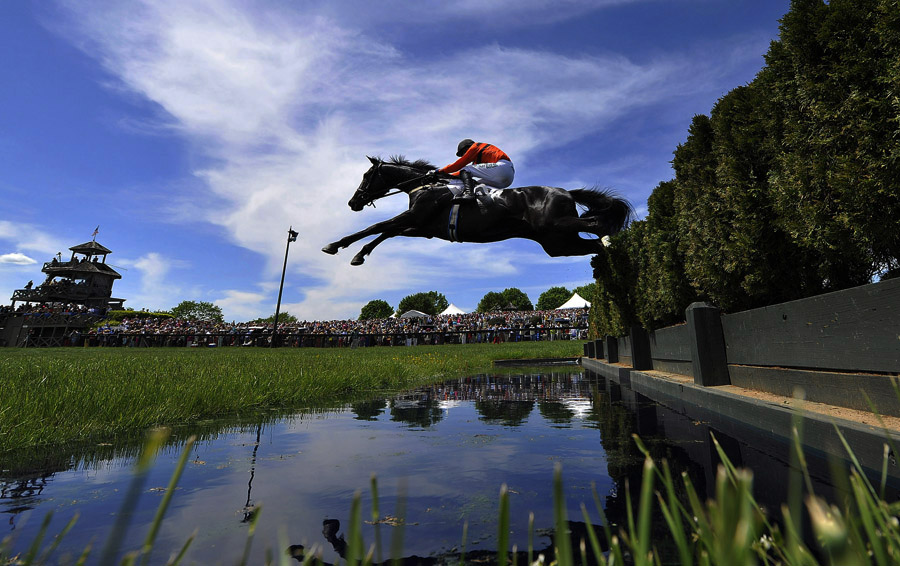Willie McCarthy riding Puller leaps a water jump in the BMW Chase during the Virginia Gold Cup Races at Great Meadow on Saturday May 04, 2013 in The Plains, VA.  (Photo by Matt McClain/ The Washington Post)