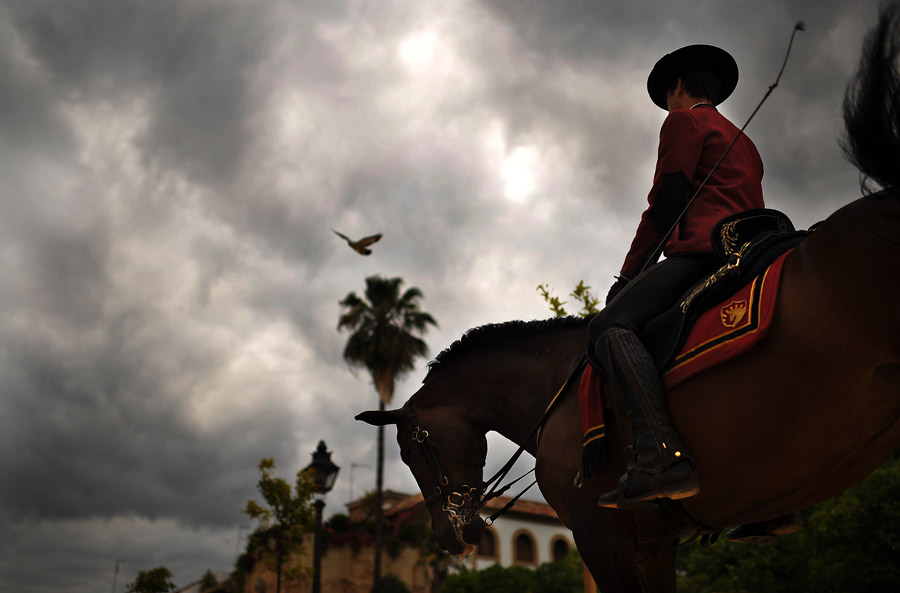 Manuel Macuils sits horseback as he advertises an equestrian event to be held later that night on Sunday June 09, 2013 in Cordoba, Spain.  The city is located in southern Spain.  (Photo by Matt McClain/ The Washington Post)