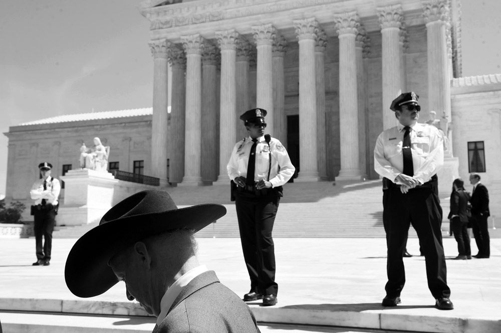 Jack Etheridge stands outside the Supreme Court of the United States on Monday April 18, 2016 in Washington, DC. Monday the court heard a case that centers on President Barack Obama's immigration policy that would prevent many people from being deported. (Photo by Matt McClain/ The Washington Post)