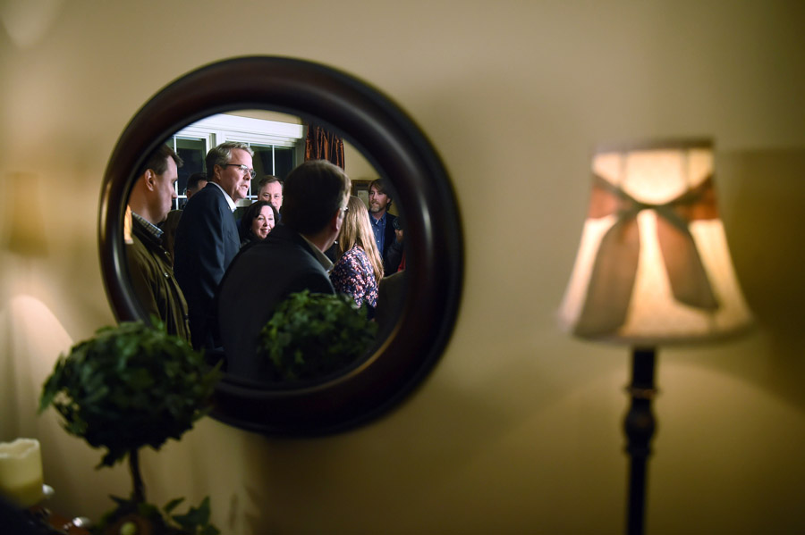 Presidential candidate, Jeb Bush is reflected in a mirror as he attends a house party at the home of Fergus Cullen on Friday March 13, 2015 in Dover, NH. (Photo by Matt McClain/ The Washington Post)