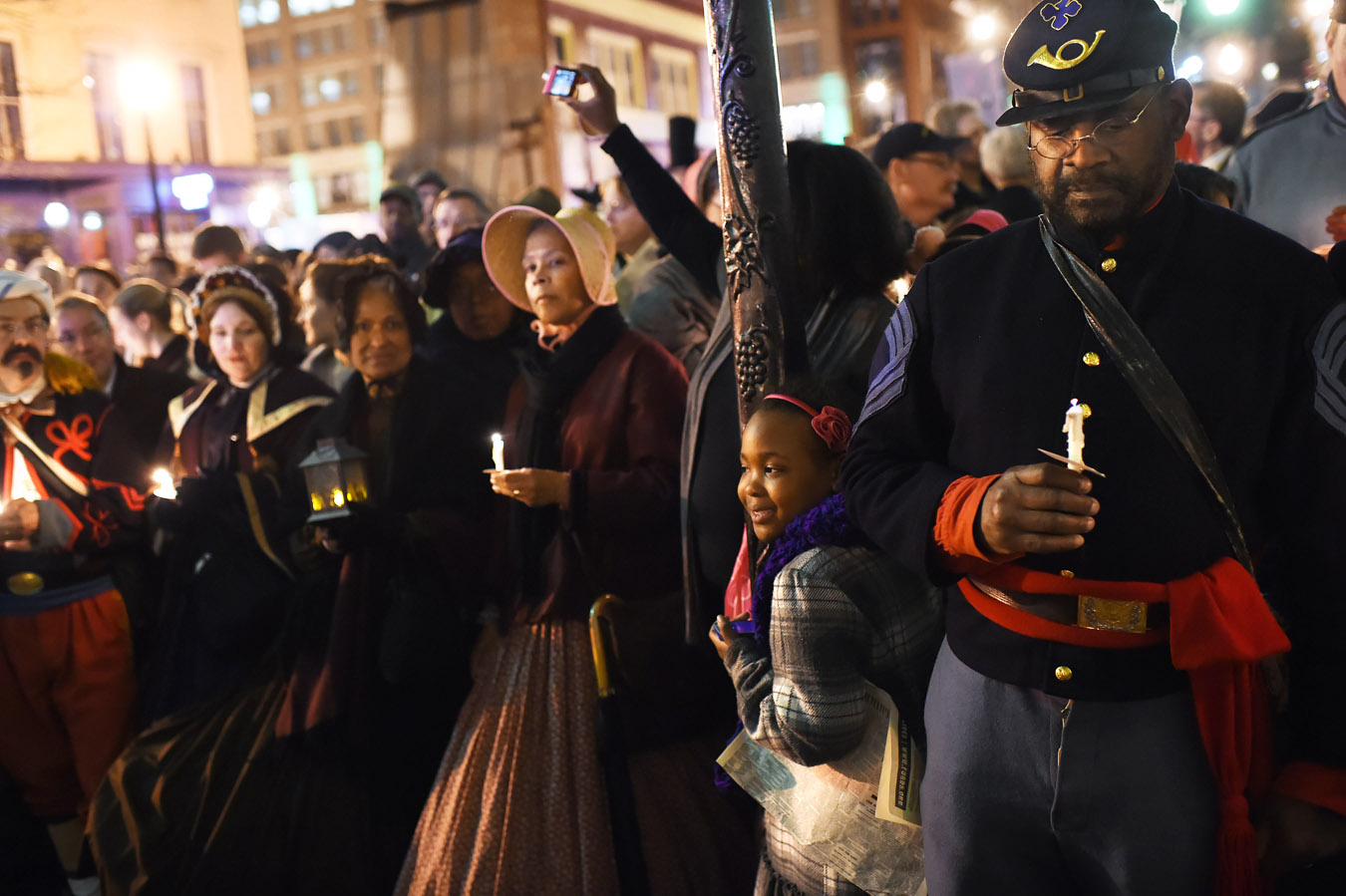 Louis Carter, right, and others gather outside Ford's Theatre in remembrance of the 150th anniversary of President Abraham Lincoln being assassinated on Tuesday April 14, 2015 in Washington, DC. Lincoln was shot at Ford's Theater on the night of April 14, 1865. He died on the morning of April 15, 1865. (Photo by Matt McClain/ The Washington Post)