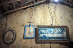 Religious items hang on a wall of a home in Comunidade Serrote do Gado Bravo de Sao Bento do Una on Saturday March 19, 2016 in Pernambuco state, Brazil. The community was founded by former slaves. (Photo by Matt McClain/ The Washington Post)