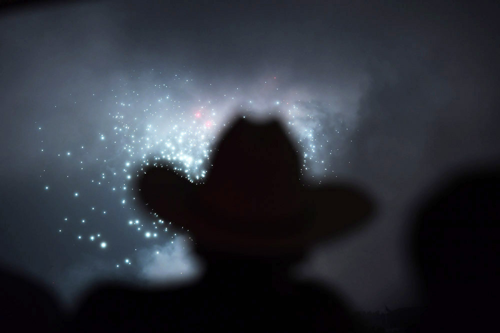 Wearing a cowboy hat, Howard Boyle gathers with others to watch fireworks from POV at W Washington, DC Hotel during the annual Fourth of July celebration on Monday July 04, 2016 in Washington, DC. (Photo by Matt McClain/ The Washington Post)