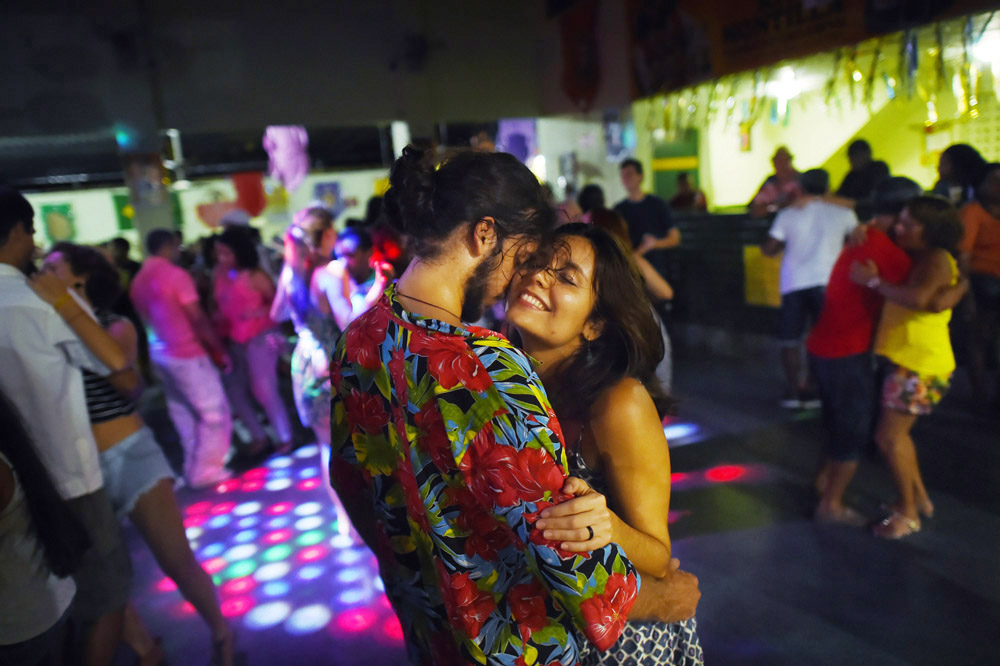 People dance at Clube Bela Vista on Sunday March 20, 2016 in Recife, Brazil. The Zika virus is rampant in the region. The virus is spread by the Aedes aegypti mosquito. There is also evidence that the virus can be spread sexually. (Photo by Matt McClain/ The Washington Post)