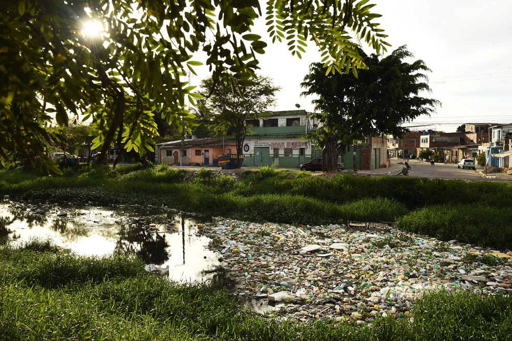 A trash filled canal is seen on Sunday March 20, 2016 in Recife, Brazil. The Zika virus is rampant in the region. The virus is spread by the Aedes aegypti mosquito. Such places are a perfect breeding ground for mosquitos. (Photo by Matt McClain/ The Washington Post)