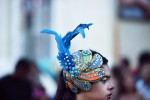 A performer takes a break as people gather to celebrate the 479th  anniversary of the founding of the city on Saturday March 12, 2016 in Recife, Brazil. The Zika virus has been rampant in this region. The virus is spread by the Aedes aegypti mosquito. (Photo by Matt McClain/ The Washington Post)