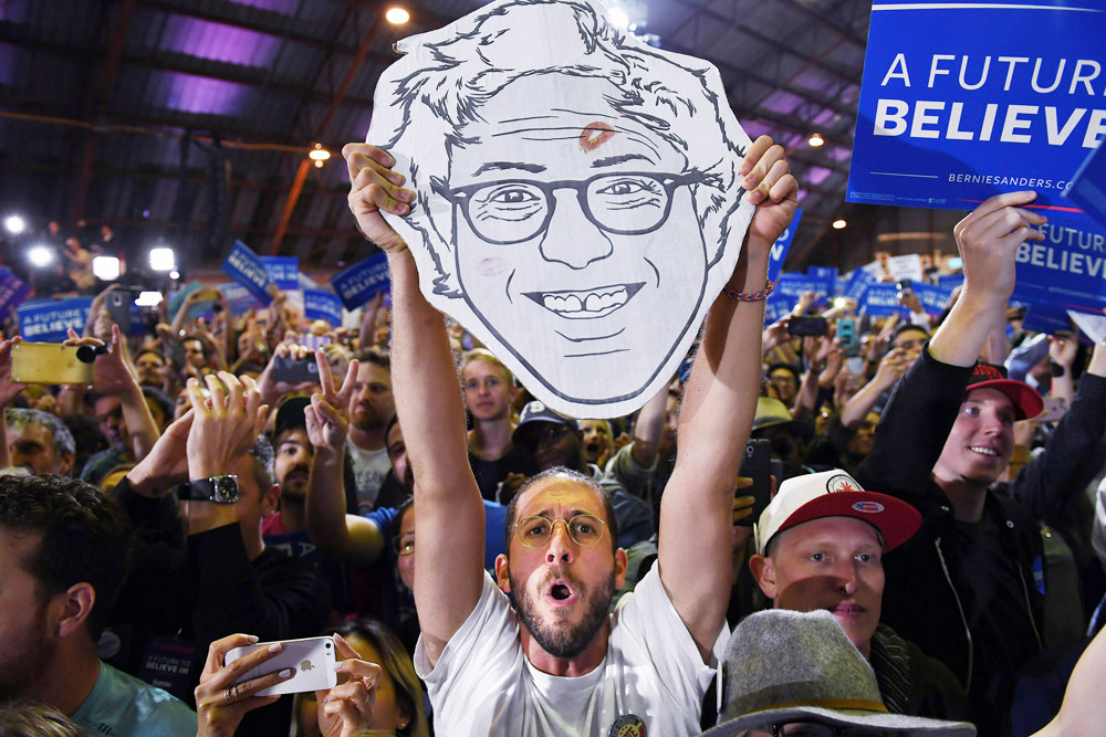 People listen to presidential candidate, Bernie Sanders speak during a rally held on the day of several primaries across the country at the Barker Hangar on Tuesday June 07, 2016 in Santa Monica, CA. (Photo by Matt McClain/ The Washington Post)