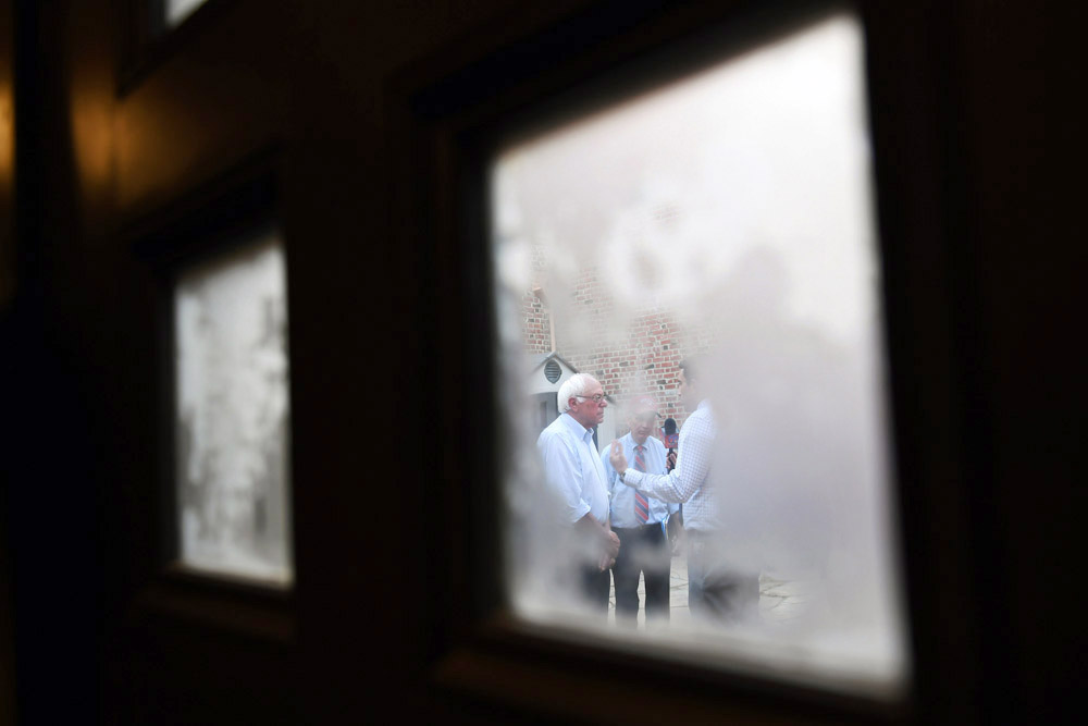 Presidential candidate, Bernie Sanders is seen through a window as he is interviewed by television reporters before a rally at California State University, Chico on Thursday June 02, 2016 in Chico, CA. The primary in California is June 7th. (Photo by Matt McClain/ The Washington Post)