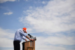 Presidential candidate, Bernie Sanders hangs his head after mispronouncing a name of a town he visited earlier in the day before speaking at a rally at Groppetti Community Stadium on Sunday May 29, 2016 in Visalia, CA. The primary in California is June 7th. (Photo by Matt McClain/ The Washington Post)
