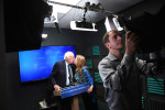 Presidential candidate, Bernie Sanders kisses his wife, Jane O'Meara Sanders as he prepares to speak for a video to supporters at Polaris Mediaworks on Thursday June 16, 2016 in Burlington, VT. (Pool Photo by Matt McClain/ The Washington Post)