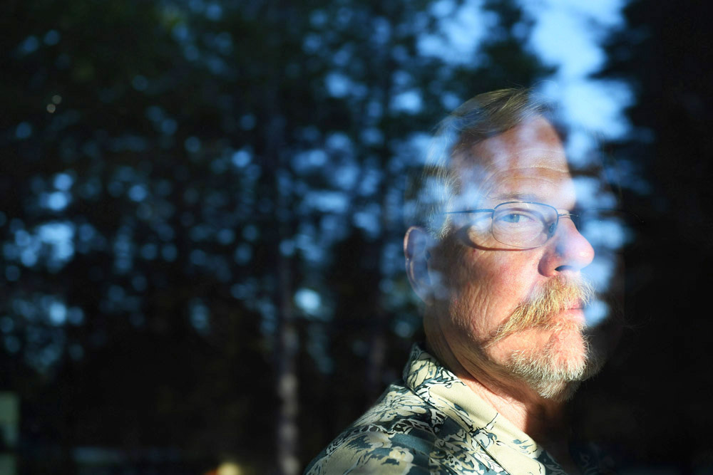 Don Bradway poses for a portrait at his home on Sunday July 31, 2016 in Hayden, ID. He and his wife, Jonna Bradway moved to Idaho from California. Northern Idaho and the surrounding area has been a refuge for people looking for an isolated place to prepare themselves for a potential collapse of society. The American Redoubt has increased this trend. (Photo by Matt McClain/ The Washington Post)
