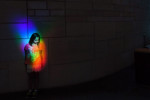 Isabella Garland, 9, of Baltimore, MD is illuminated by a rainbow created by prisms at the Smithsonian National Museum of the American Indian on Monday August 15, 2016 in Washington, DC. (Photo by Matt McClain/ The Washington Post)