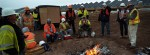 Workers keep warm near a fire during a break while working at the Greater Sanhill Solar Project being constructed by SunPower Corporation outside of Alamosa, Colo. on Thursday 10/21/10.  Photo by Matt McClain