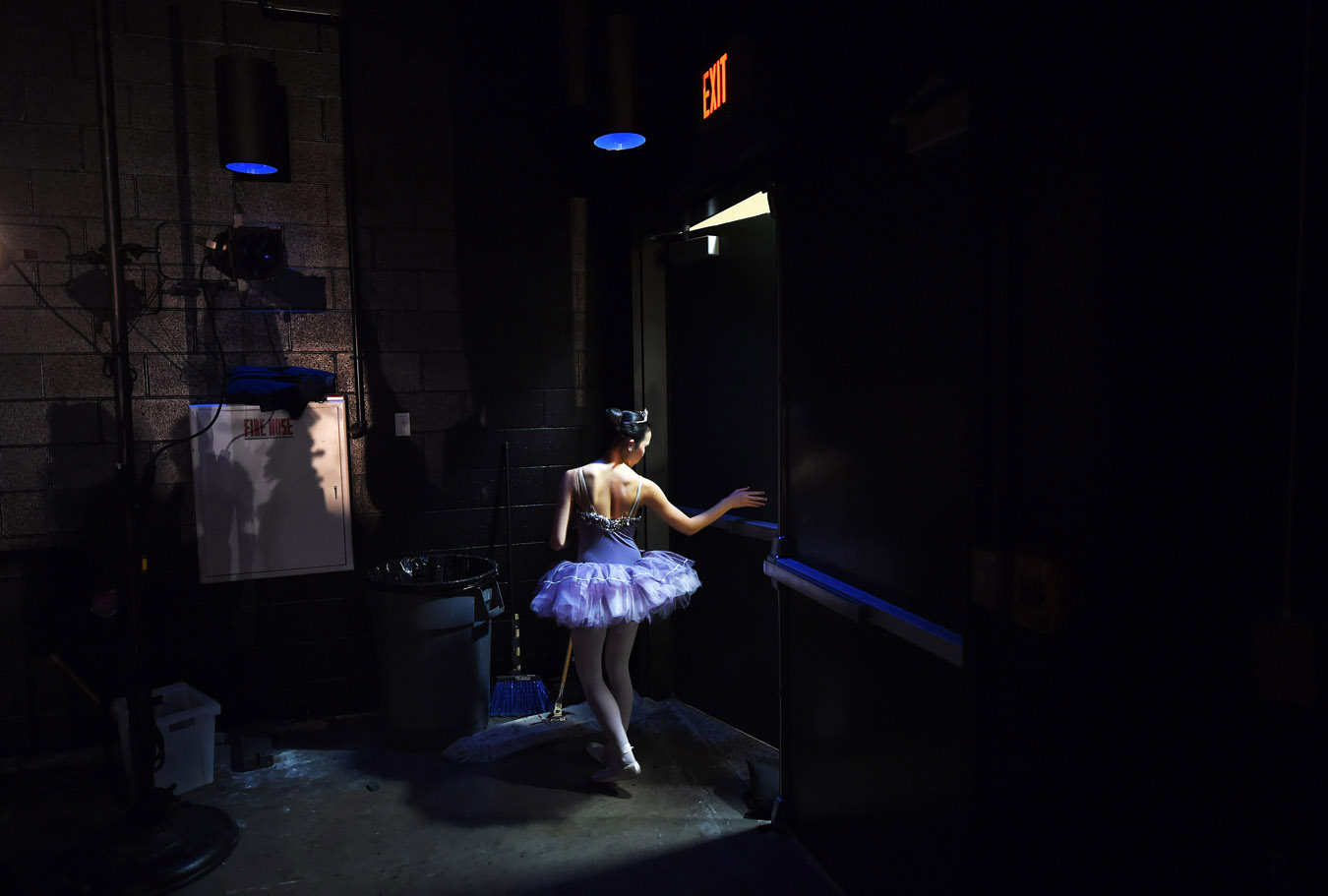 Dayna Richards, 15, heads backstage to wait for her cue during a performance of {quote}The Nutcracker{quote} by the Fredericksburg Ballet Centre at James Monroe High School on Sunday December 21, 2014 in Fredericksburg, VA. This was the final performance of {quote}The Nutcracker{quote} by the Fredericksburg Ballet Centre for the holiday season. (Photo by Matt McClain/ The Washington Post)