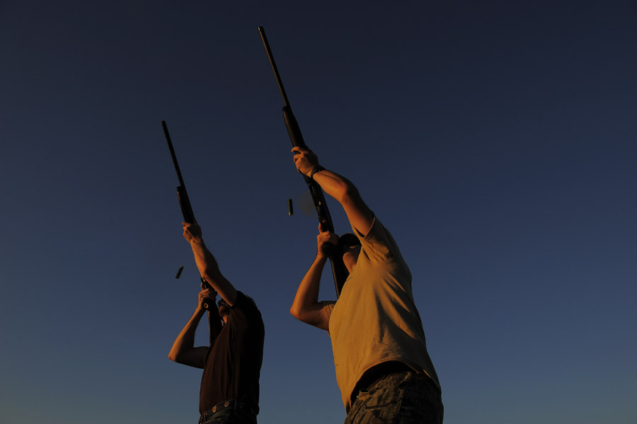 Tom Egeland, Jr., left, and his brother, Jeff Egeland, right, take part in the annual dove hunt at the Shady Grove Kennel and Hunting Preserve on Saturday September 14, 2013 in Remington, VA.  (Photo by Matt McClain/ The Washington Post)