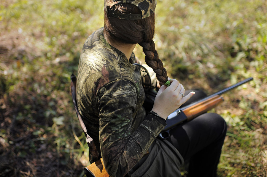 Sam Strawder, 23, takes part in the annual dove hunt at the Shady Grove Kennel and Hunting Preserve with her family on Saturday September 14, 2013 in Remington, VA.  (Photo by Matt McClain/ The Washington Post)