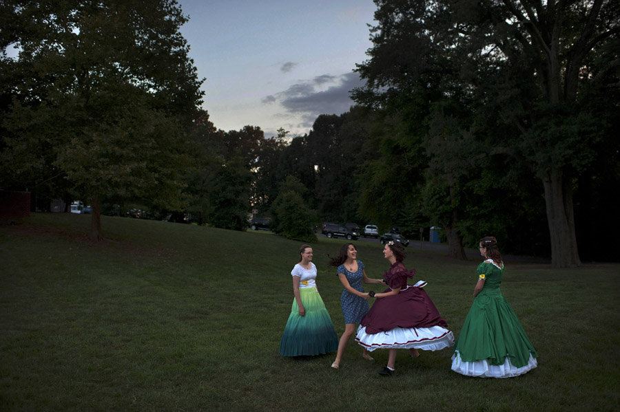 Emily Dixon, center, and Tiffany Herleikson, far right, watches as Julie Snead, second from center, and Sarah Dixon, center right, dance during the Manassas Civil War Weekend on Saturday August 24, 2013 in Manassas, VA.  (Photo by Matt McClain/ The Washington Post)