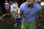 Thomas Howard, left, looks on as Patrick Greco, right, plays bocce ball before a college ball at the University of Virginia on Saturday August 31, 2013 in Charlottesville, VA.  The University of Virginia has a tradition of members of the student body dressing up for game day.  The tradition is called, {quote}guys in ties, girls in pearls{quote}.  (Photo by Matt McClain/ The Washington Post)