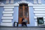 A man plays an accordion for tips on Friday July 03, 2015 in Old San Juan, Puerto Rico. The historic area brings in countless tourists. (Photo by Matt McClain/ The Washington Post)