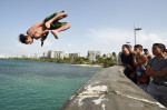 Rafael Velez jumps from a bridge into Laguna del Condado on Saturday July 04, 2015 in San Juan, Puerto Rico. Many people headed to local beaches and waterways to spend the Fourth of July. (Photo by Matt McClain/ The Washington Post)