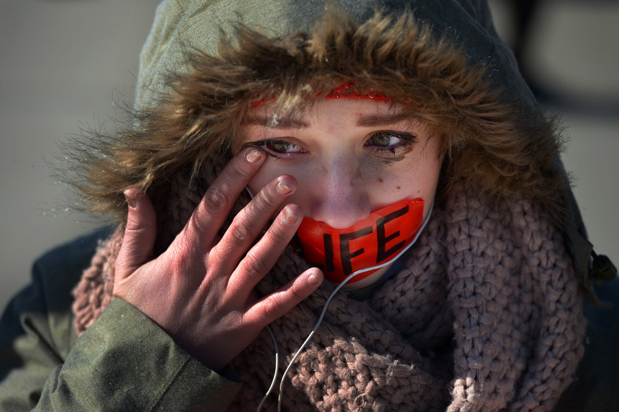 Rachele Johnson of Pennsylvania wipes her eye as she and other pro-life supporters demonstrate outside the Supreme Court of the United States on the 40th anniversary of the landmark case of Roe vs. Wade on Tuesday January 22, 2013 in Washington, DC.  Both pro-choice and pro-life demonstrators braved cold temperatures.  (Photo by Matt McClain for The Washington Post)
