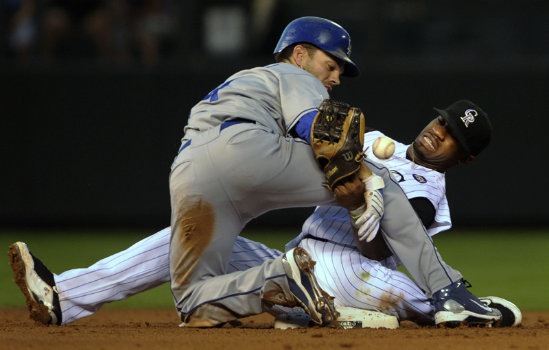 Los Angeles Dodgers' Jamey Carroll, left, steals second base after Eric Young Jr., right, loses the ball while applying the tag in the second inning of a baseball game at Coors Field in Denver, Colo. on Saturday, August 27, 2010.  (AP Photo/ Matt McClain)