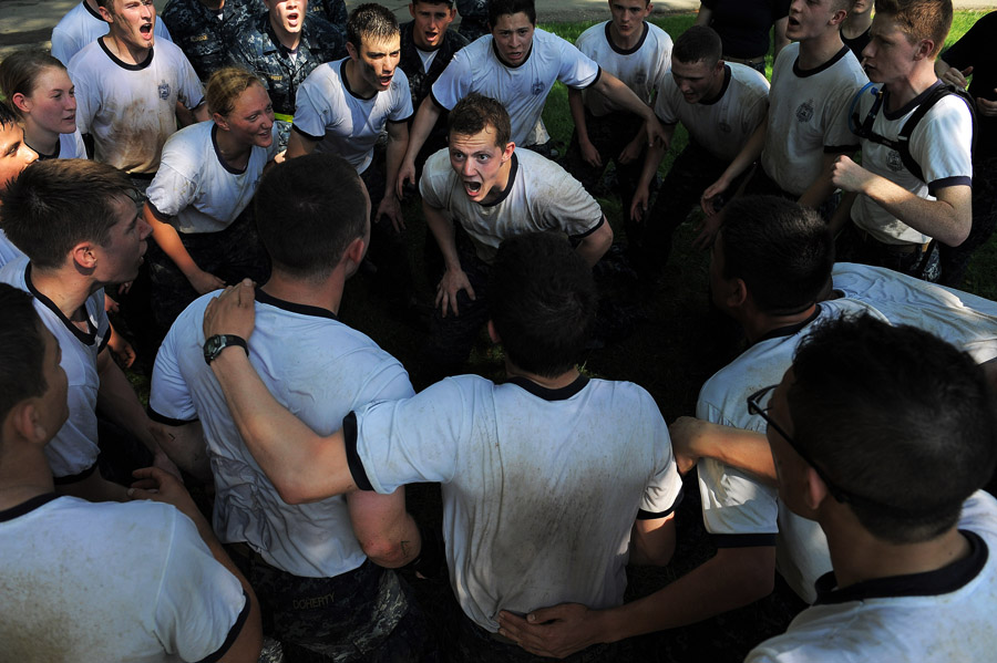 United States Naval Academy plebes huddle up to get inspired for another round of tug of war as they take part in Sea Trials on Tuesday May 13, 2014 in Annapolis, MD.  The event consists of a variety of activities and obstacles.  (Photo by Matt McClain/ The Washington Post)