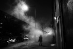 A man is engulfed in steam along D St. NW on a cold Wednesday January 29, 2014 in Washington, DC.  (Photo by Matt McClain/ The Washington Post)