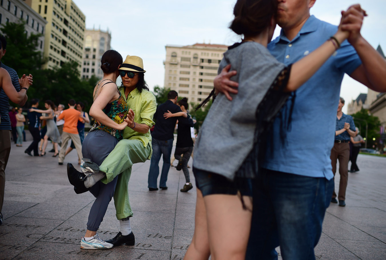Sylvia Christie, left, and Dong Kim, left center, take part in tango dancing at Freedom Plaza on Sunday June 07, 2015 in Washington, DC. (Photo by Matt McClain/ The Washington Post)