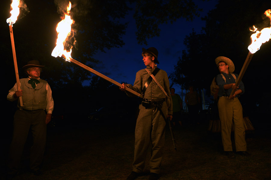 Historical interpreters, David Meisky, left to right, Alex Hughes, and Tom Maples, take part in a reenactment of a Stonewall Jackson raid during the Manassas Civil War Weekend on Saturday August 24, 2013 in Manassas, VA.  (Photo by Matt McClain/ The Washington Post)